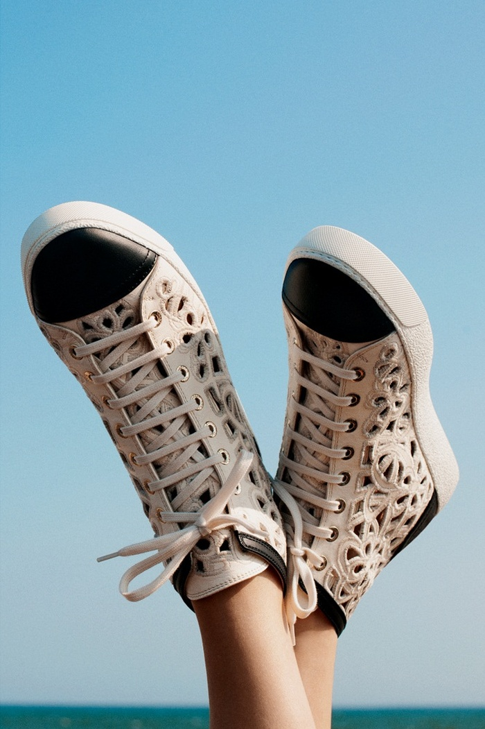 Isabeli Fontana Models Resort Swimwear for Bergdorf Goodman