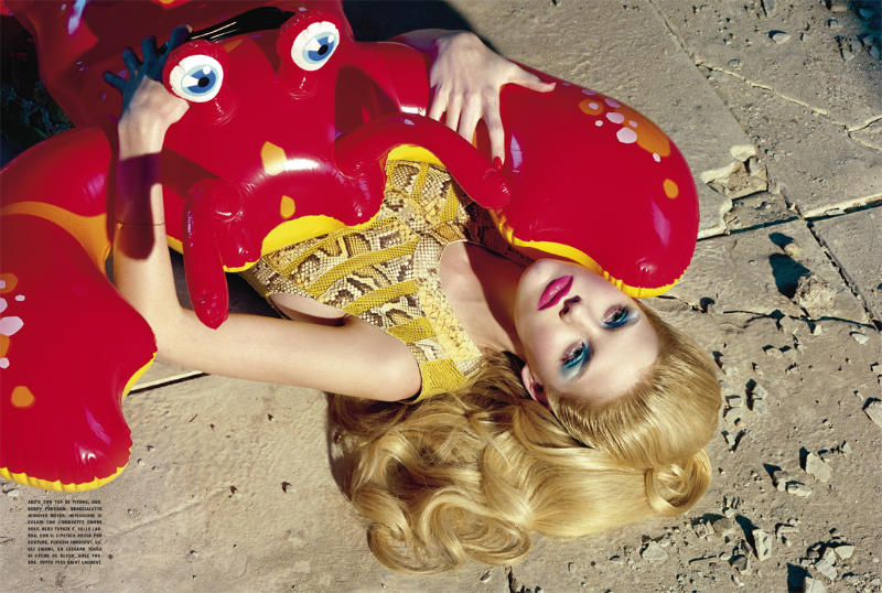 Ashley Smith played with pool toys for Vogue Italia's May issue. / Photo by Miles Aldridge