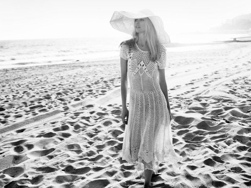 Claudia Schiffer soaked up the sun in Harper's Bazaar UK July. / Photo by Horst Diekgerdes